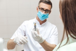 Dentist and patient during dental implant consultation
