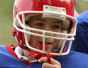 Boy with football helmet and mouthguard
