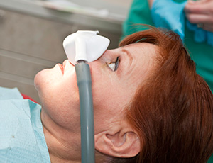 Woman in dental chair with nitrous oxide mask
