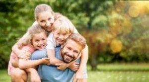 Smiling family in the spring season