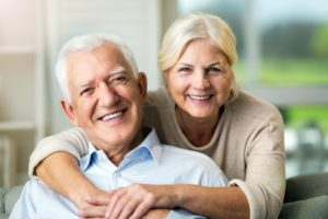 Older couple with beautiful smiles
